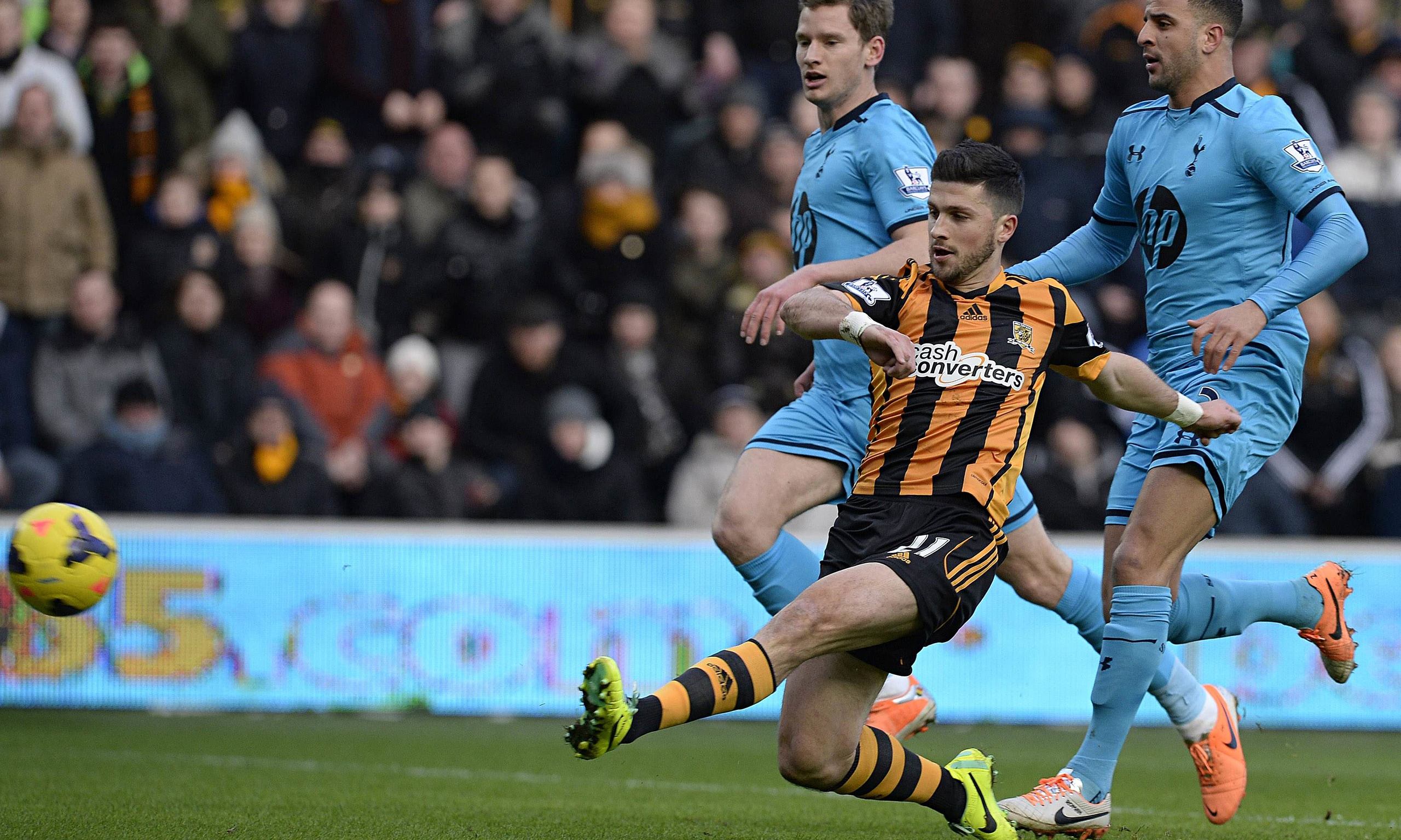 Hull's Shane Long, centre, scores against Tottenham Hotspur in the Premier League at the KC Stadium